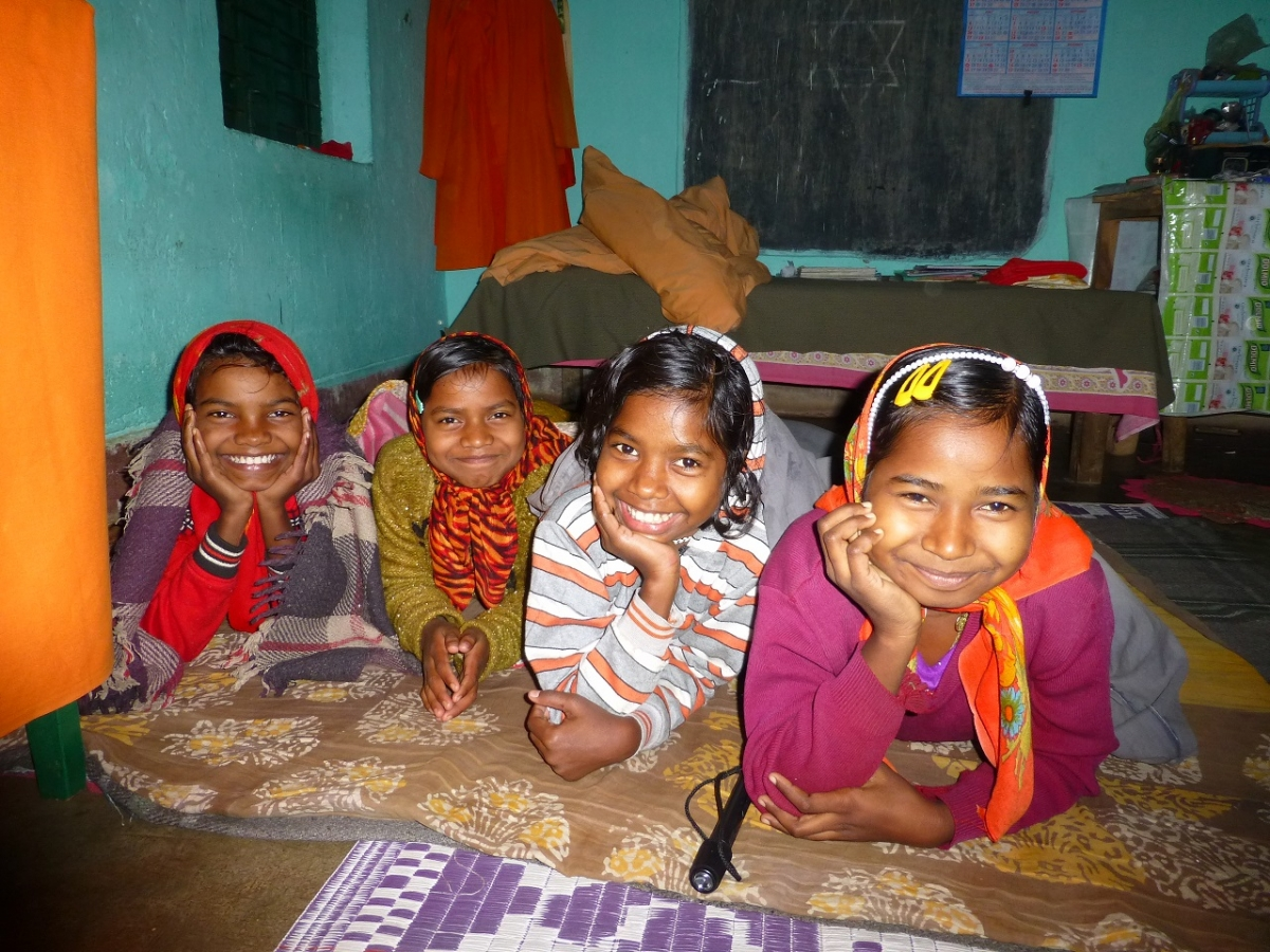 Bobby, Sucita and Sudha together with Priyanka preparing to sleep on the floor of their hostel