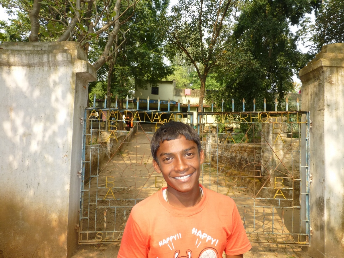 Kishore in front of his hostel