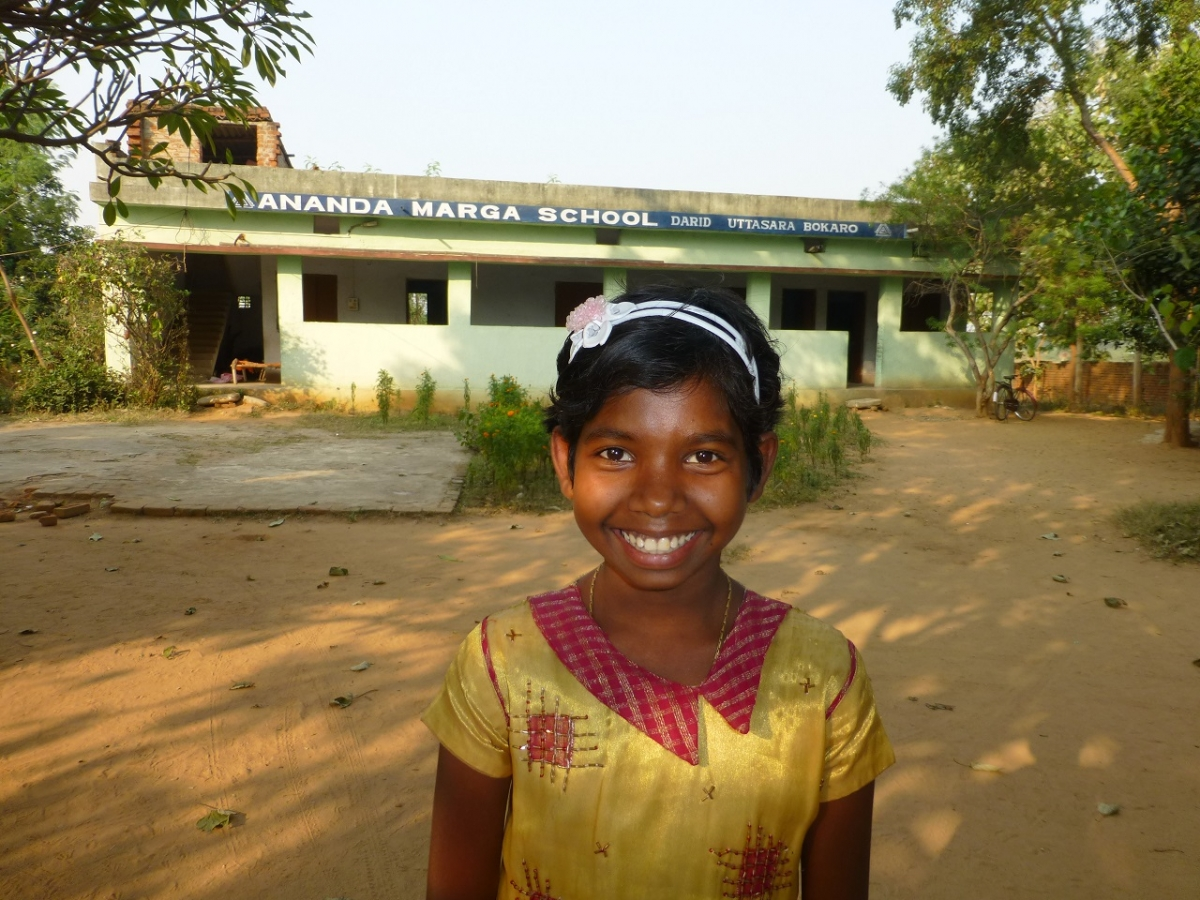 Sucita in front of her school