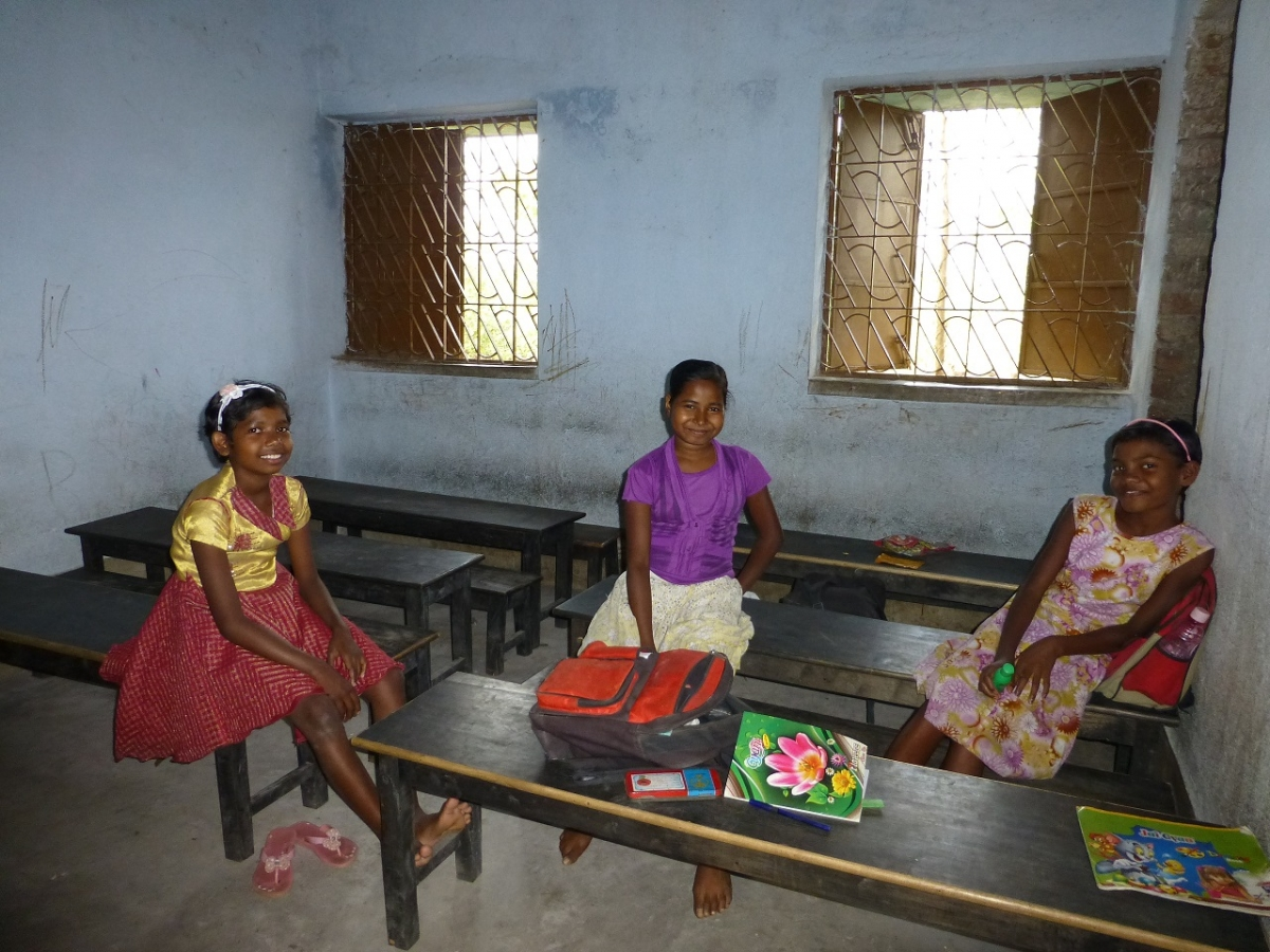Sucita, Sudha and Bobby relaxing in their classroom